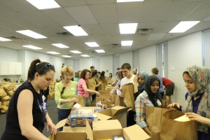 TechGirls volunteer with Alive! Inc.. bagging and transporting food for those less fortunate.