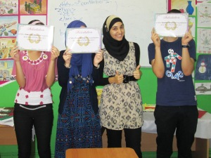 Assia stands with her web design students who recently completed the course she taught